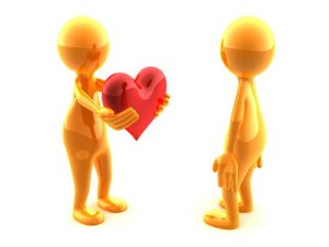 A person giving a beautiful red heart to another person.
